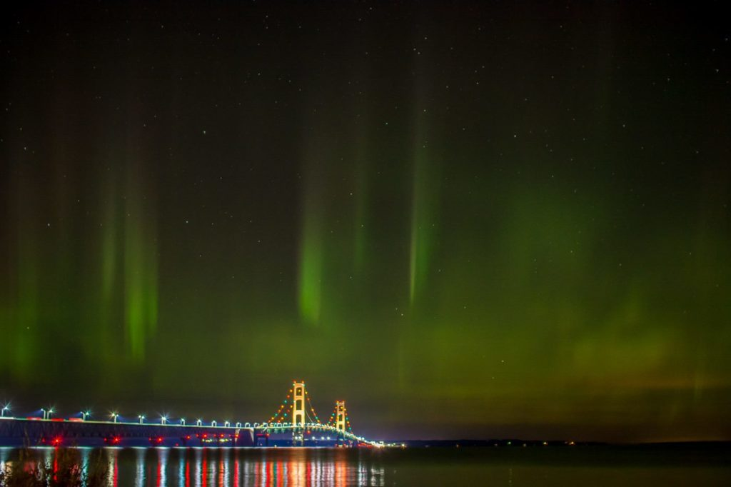 The Mackinac Bridge was beautifully draped in aurora Labor Day weekend, 2016, as captured by Jason Gillman