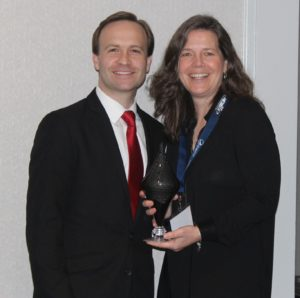 Headlands Program Director Mary Stewart Adams with Michigan's Lt. Governor Brian Calley, celebrating the 2017 Pure Award at the Governor's Pure Michigan Conference on Tourism held in Detroit, March, 2017